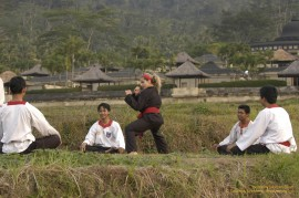 Trish Stratus faces off against her opponent in a Pecak Silat match in Java, Indonesia on STRATUSPHERE.