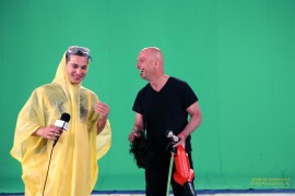 """Howie Mandel discarding his """"€œLarry""""€ disguise to reveal his true identity to an unwitting participant in """"€œWeather or Not?""""€ on HOWIE DO IT."""