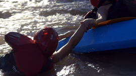 Amanda and Erika find themselves in rough water on a kayak adventure in Laos.
