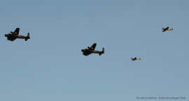 The two Lancs in air show formation with a Hurricane and Spitfire